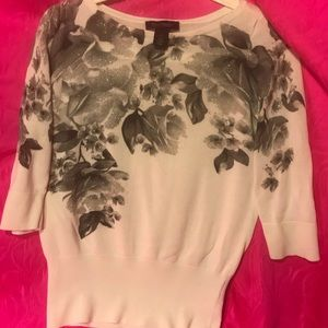 Light top with black and gray floral print